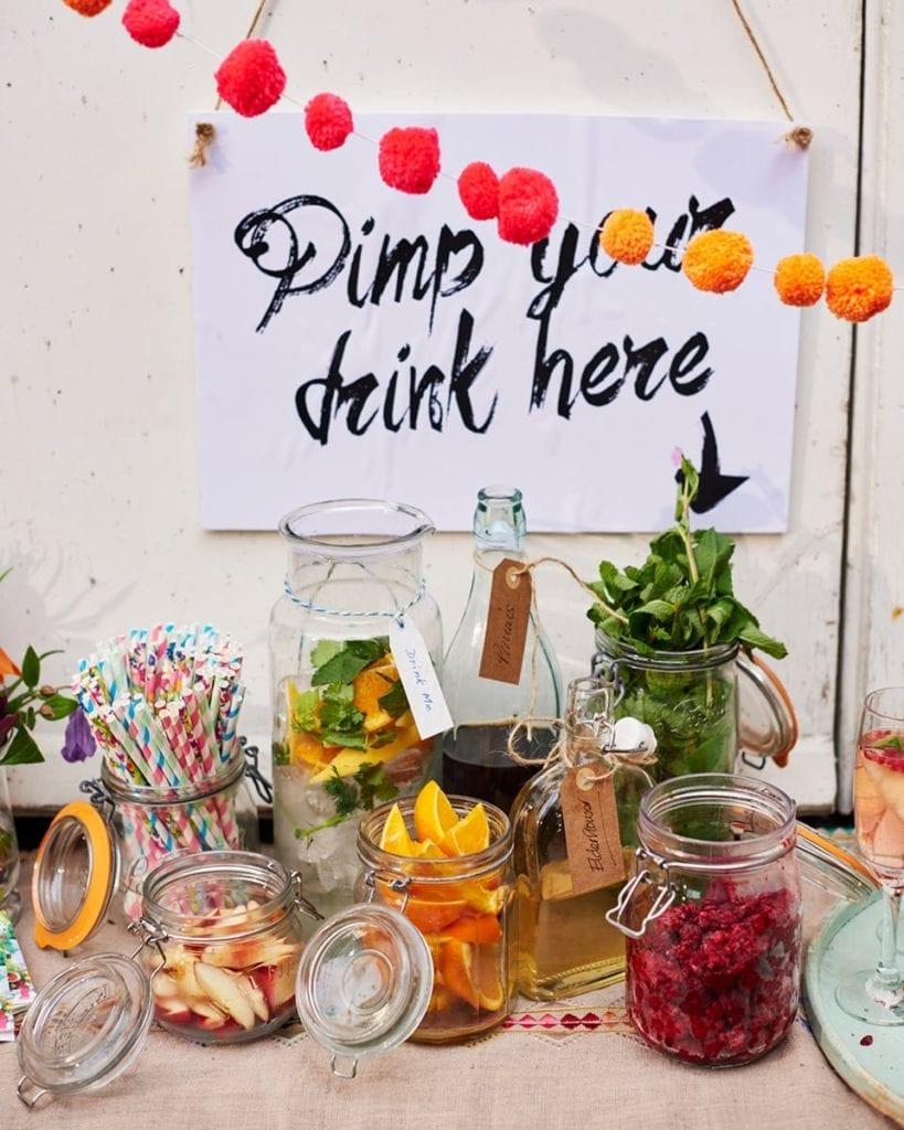 Pimp your drink sign above jars of fruit