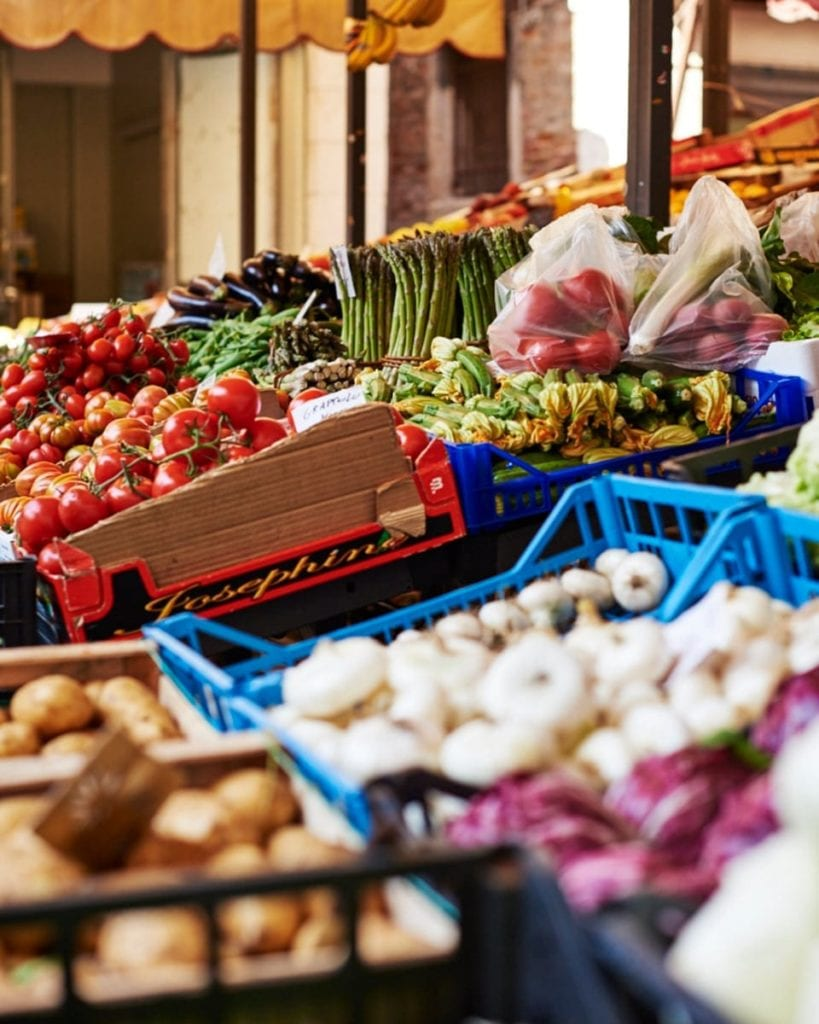 Image of market stall in Venice laden with fruit and veg