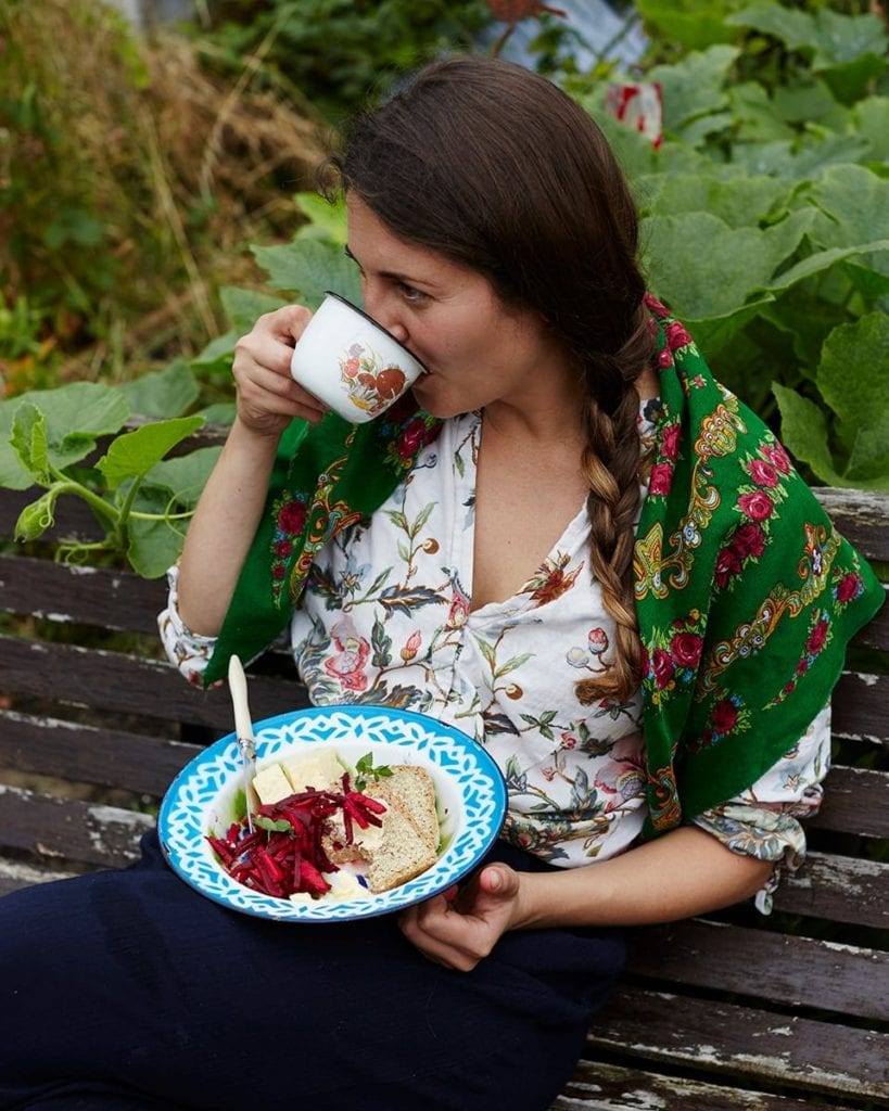 Image of Olia eating lunch and drinking tea in the garden