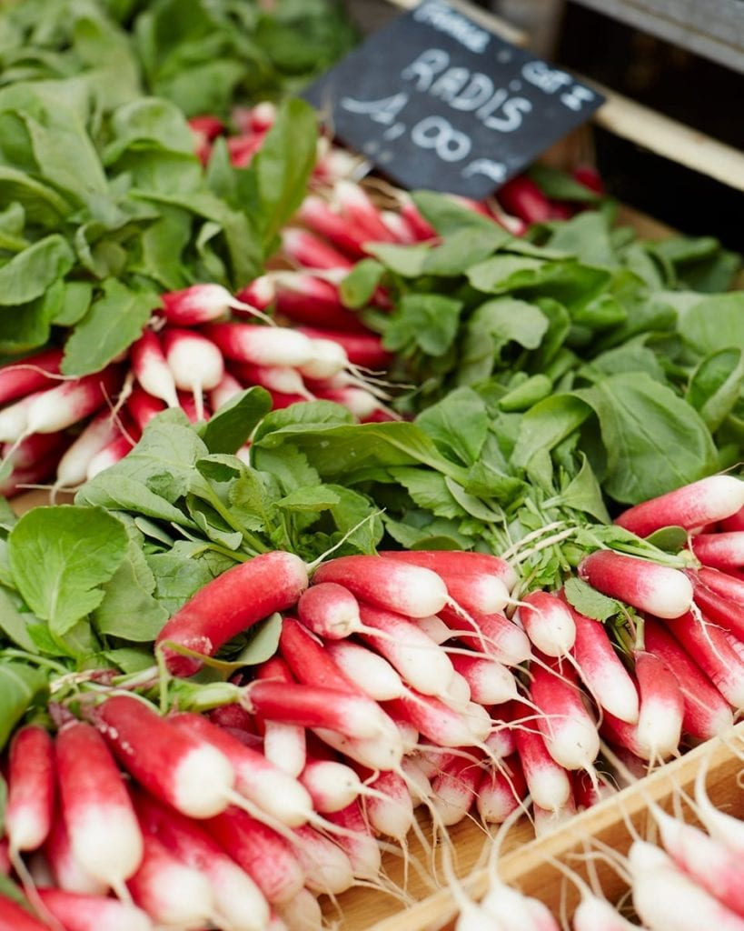 Image of pink radishes for sale at a French market