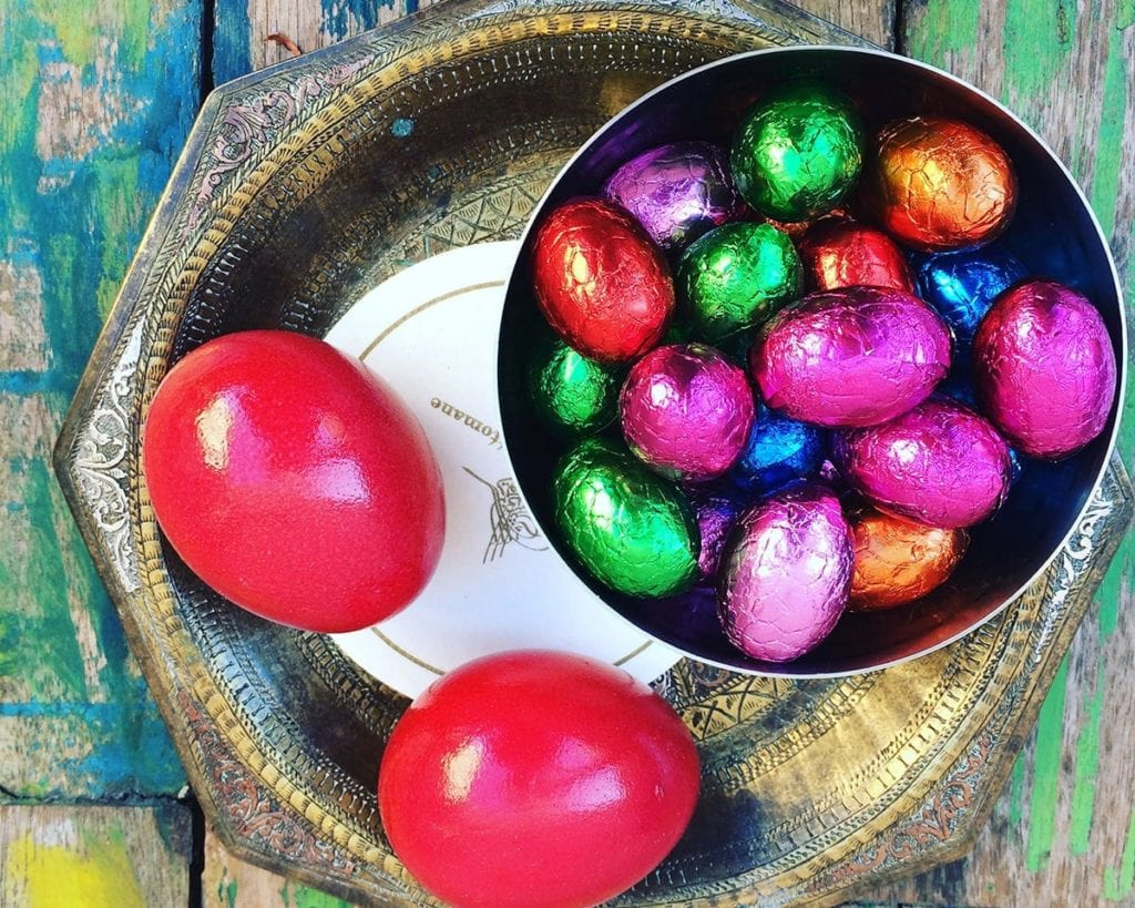 Image of chocolate Easter eggs and dyed eggs