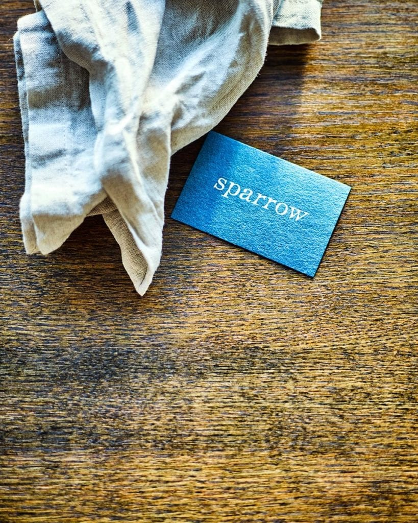 Image of a Sparrow business card and napkin on the table