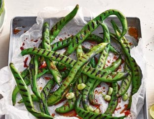 Charred broad beans with soy and mirin dressing and smoked chilli salt