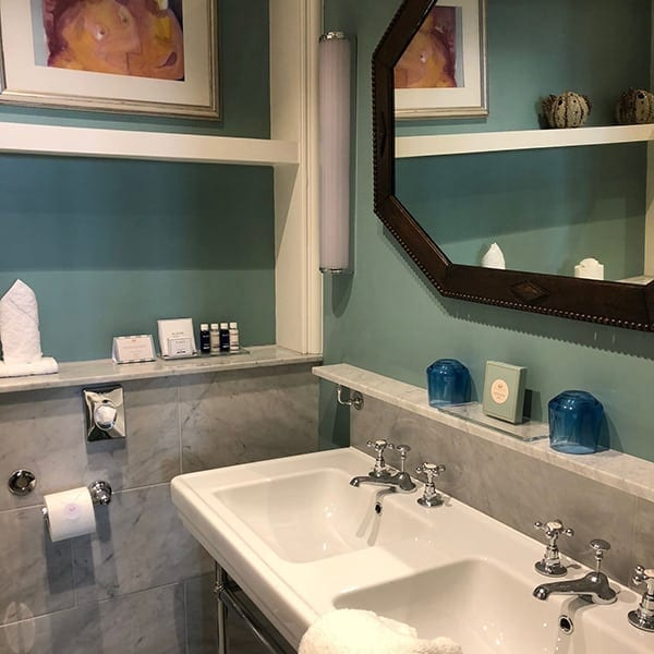 Image of double sinks in hotel bathroom