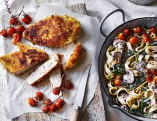 Mushroom tagliatelle alfredo with roast tomatoes and chicken milanese