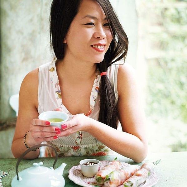 Uyen Luu eating summer rolls