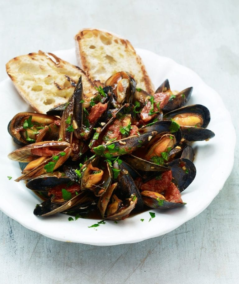 Mussel, tomato and chorizo ragù on garlic toasts