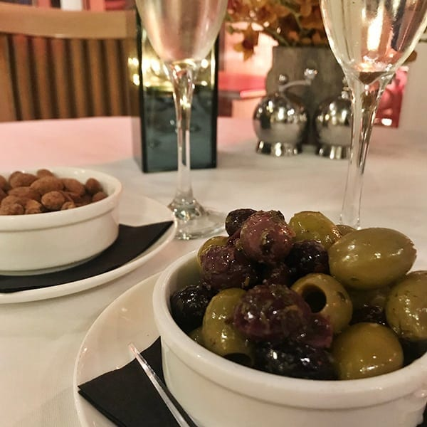Image of olives and almonds at restaurant