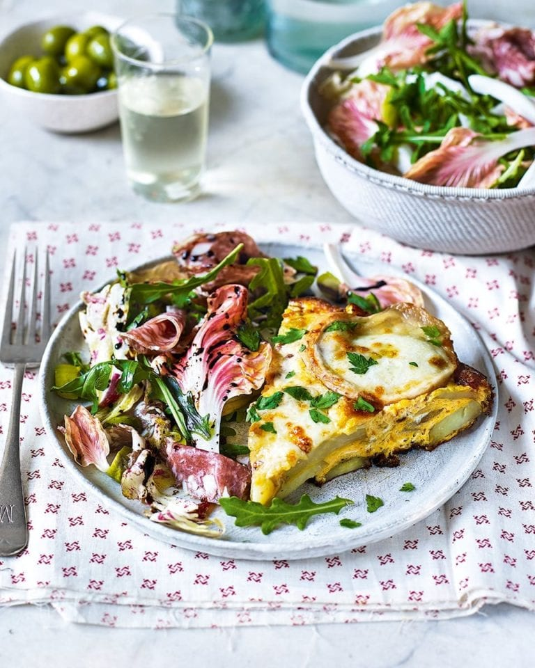 Cheesy potato frittata with radicchio, salami and olive salad
