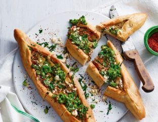 Turkish pide with marinated artichokes, broccoli and cheese
