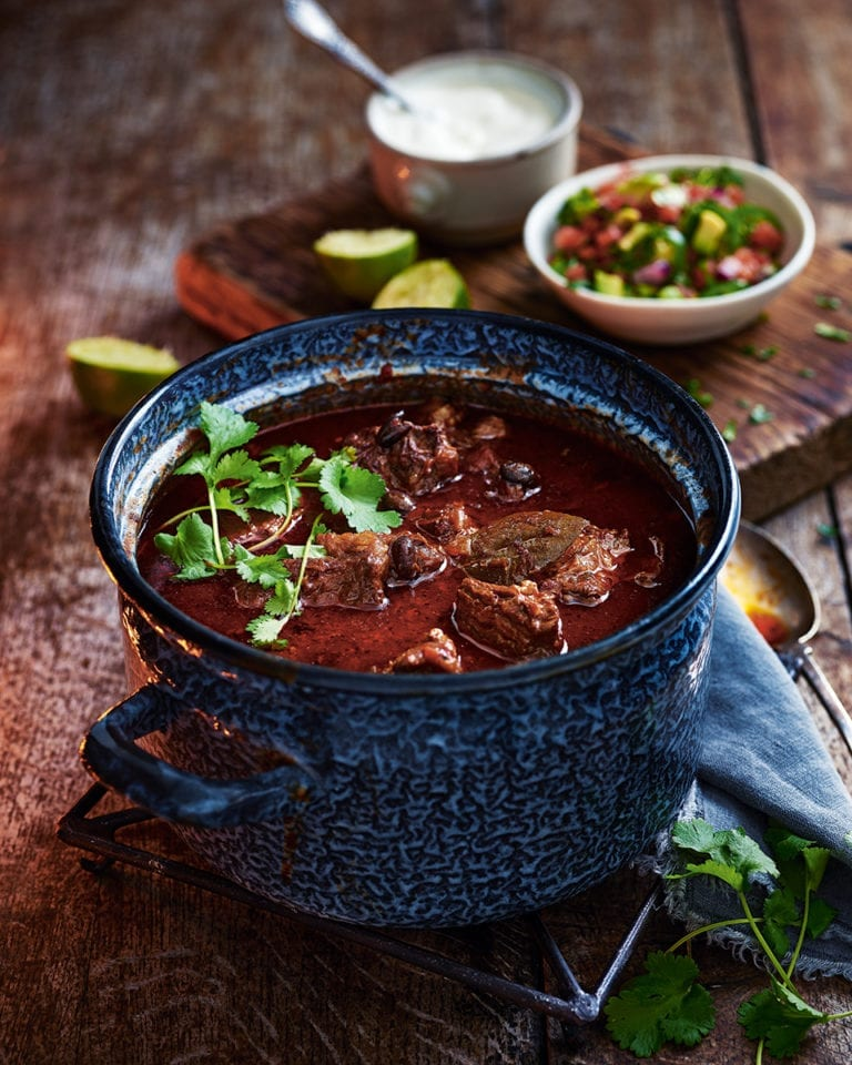 Real black bean chilli con carne with avocado and lime salsa