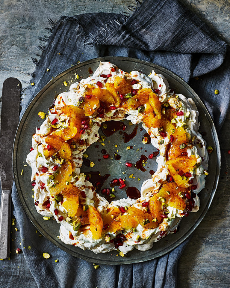 Negroni meringue pavlova wreath with pomegranate and pistachio