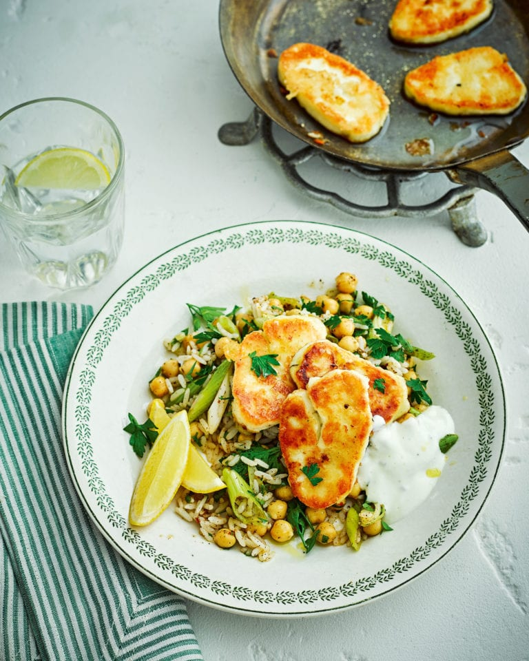 Fried halloumi with warm harissa, rice and chickpea salad