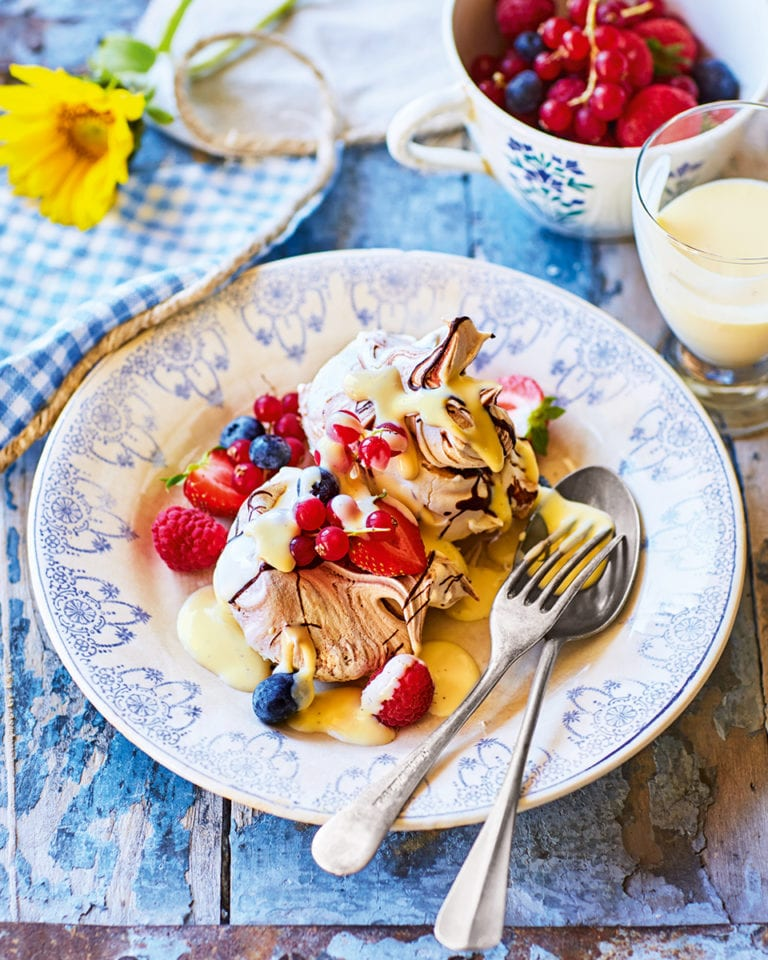 Chocolate swirl meringues, berries and white chocolate sauce