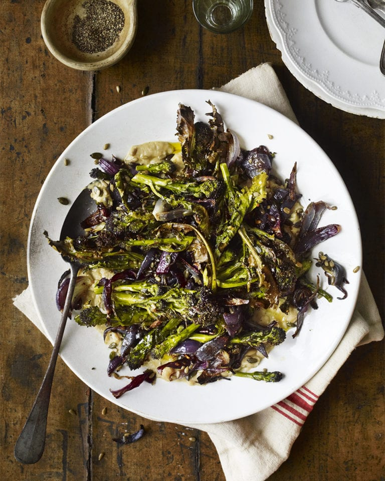 Roast purple sprouting broccoli with smashed white beans