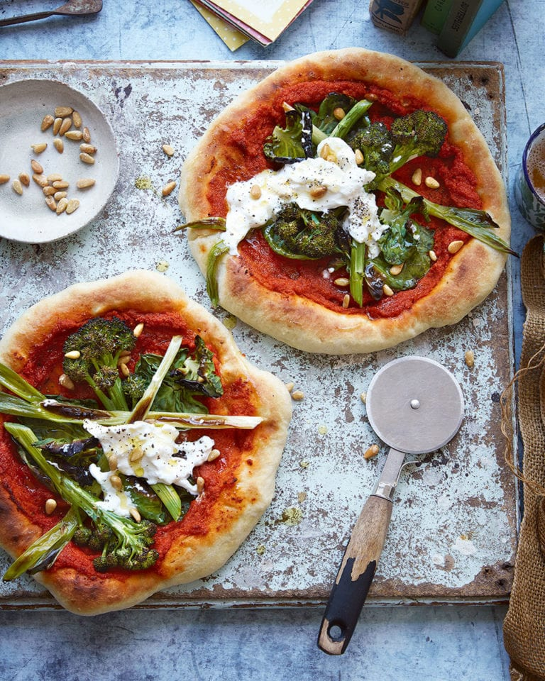 Pizzas with romesco sauce and greens