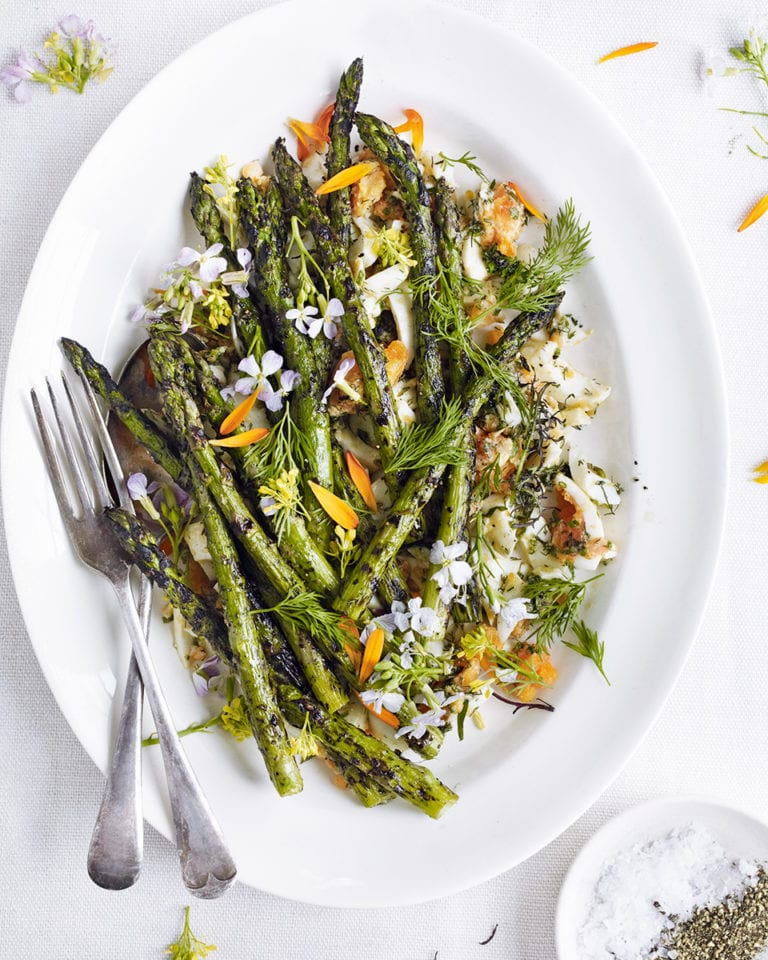 Barbecued asparagus with chopped eggs, tarragon, chives and dill