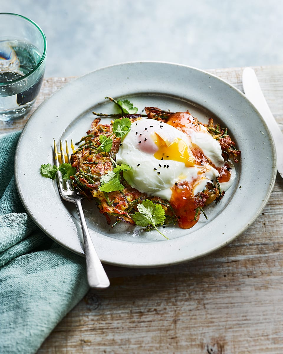 Spiced onion fritters with poached eggs | delicious. magazine