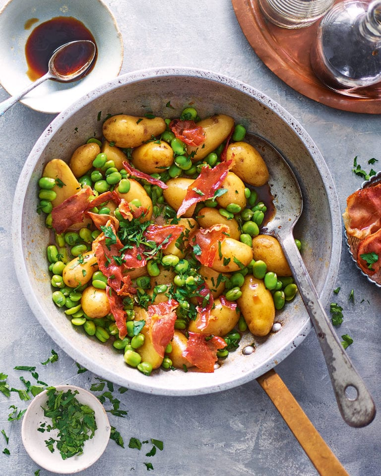 Sherry braised jersey royals with broad beans and serrano ham