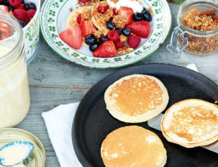 Jam jar pancakes with berries and crumbled flapjacks