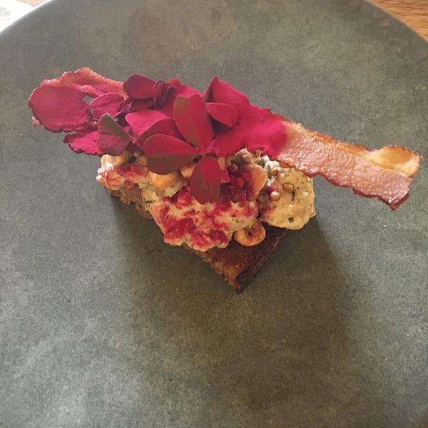 New potato and crispy pig's ear smørrebrød at selma copenhagen