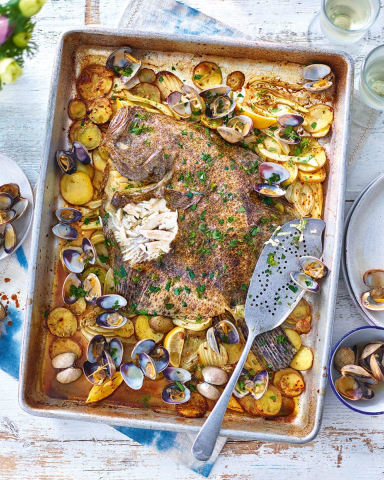 Whole roast turbot with clams, fennel and potatoes