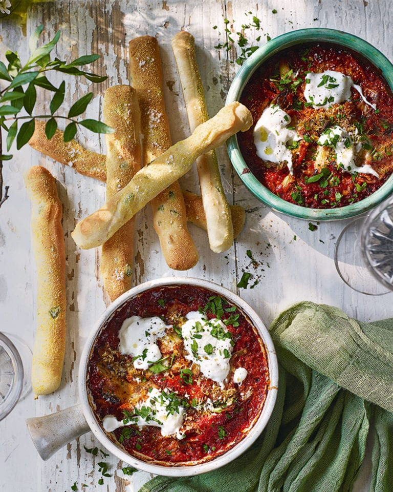 Baked 'nduja and burrata dip with olive breadsticks
