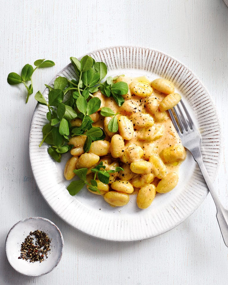 Cacio e pepe gnocchi with mint and pea shoots