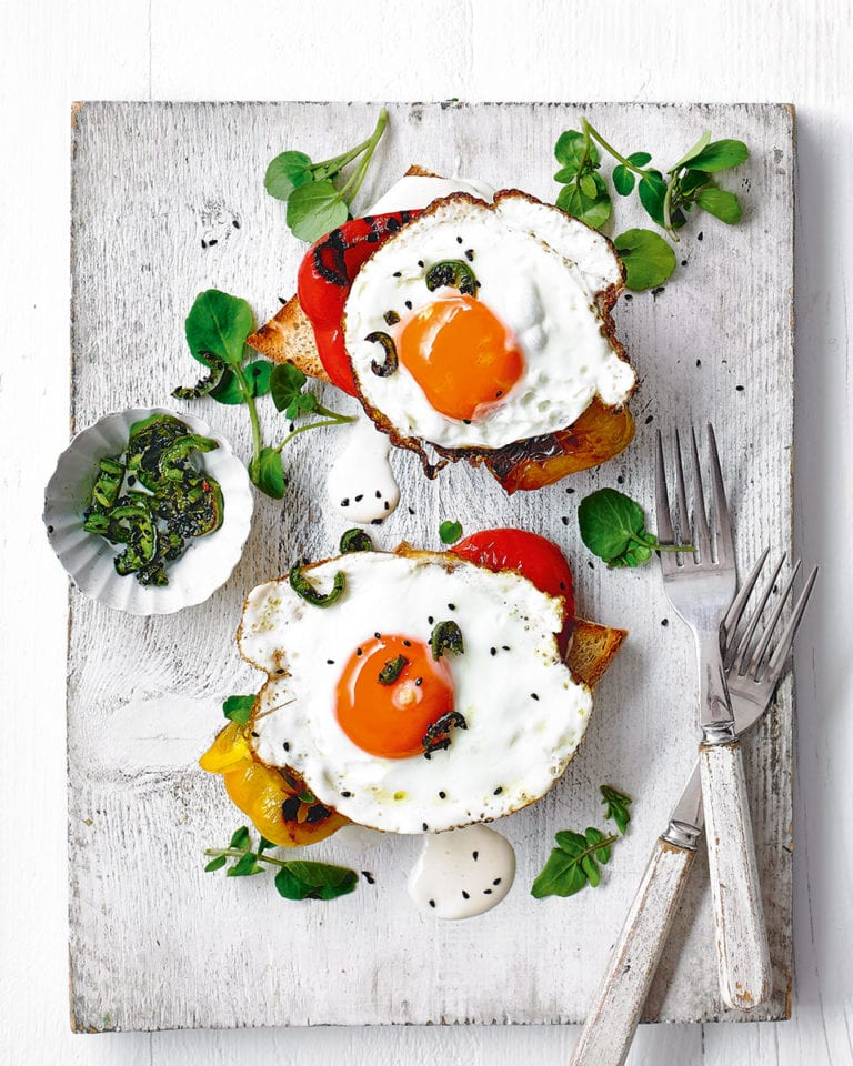 Fried eggs on toast with grilled peppers and aioli