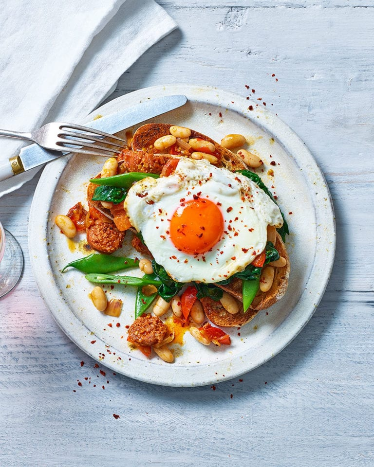 Beans and greens on toast with chorizo and egg