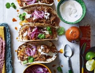 Slow-cooked chicken tinga tacos with pickled onions