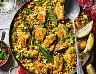 Chicken paella with squid and beans