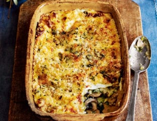 Kale, leek and mushroom lasagne with blue cheese topping