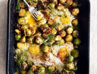 Roast brussels sprouts with caramelised onions and baked eggs