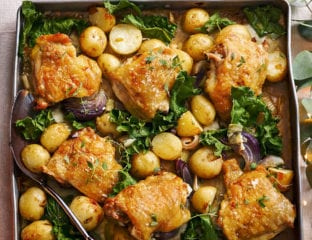 Roast chicken thighs with new potatoes and greens