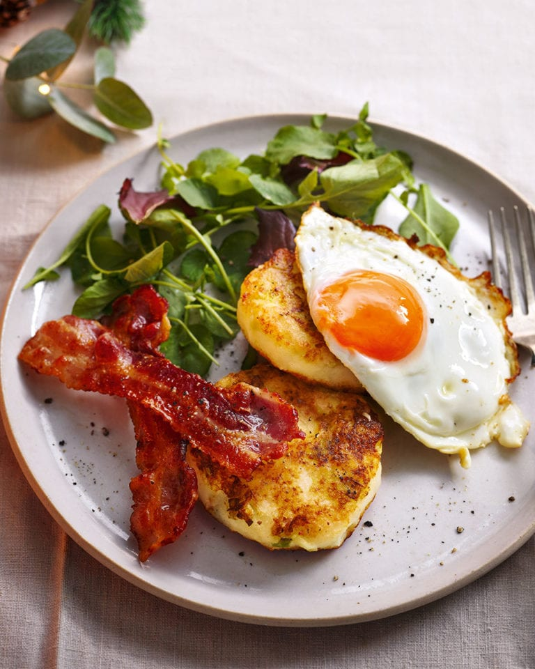 Potato champ cakes with crispy bacon and fried eggs