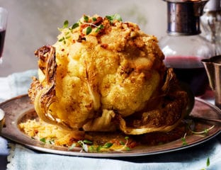 Whole roasted cauliflower with leeks and cheese sauce