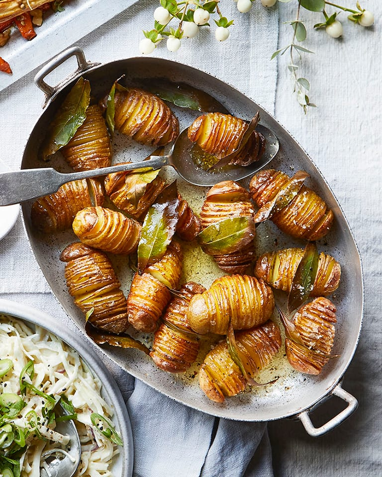 Roast hasselback potatoes with bay and brandy butter