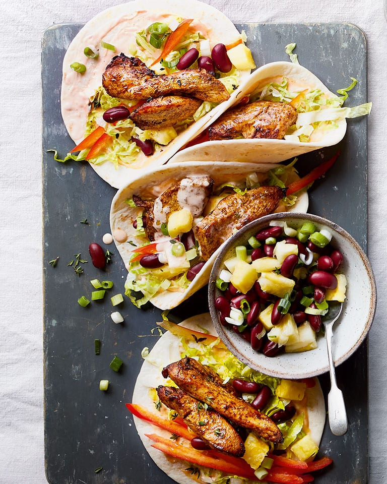 Jerk chicken wraps with bean salsa and spicy mayo
