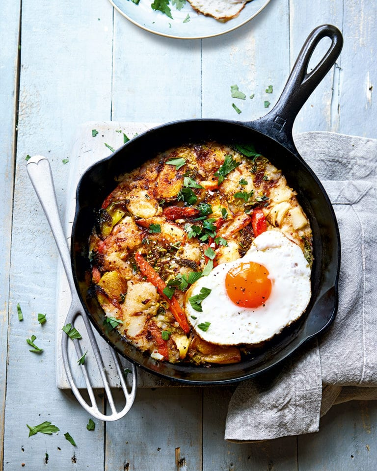 Veggie hash with fried eggs