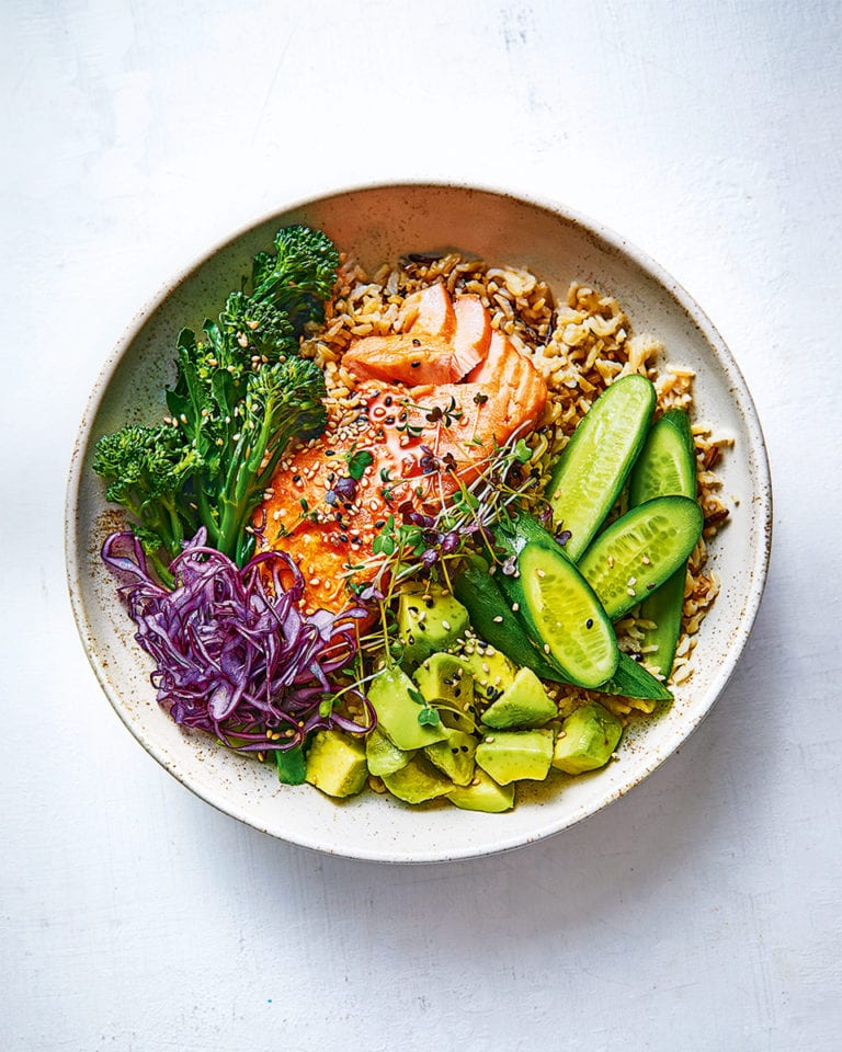 Salmon and avocado rice bowl with soy and lemon dressing
