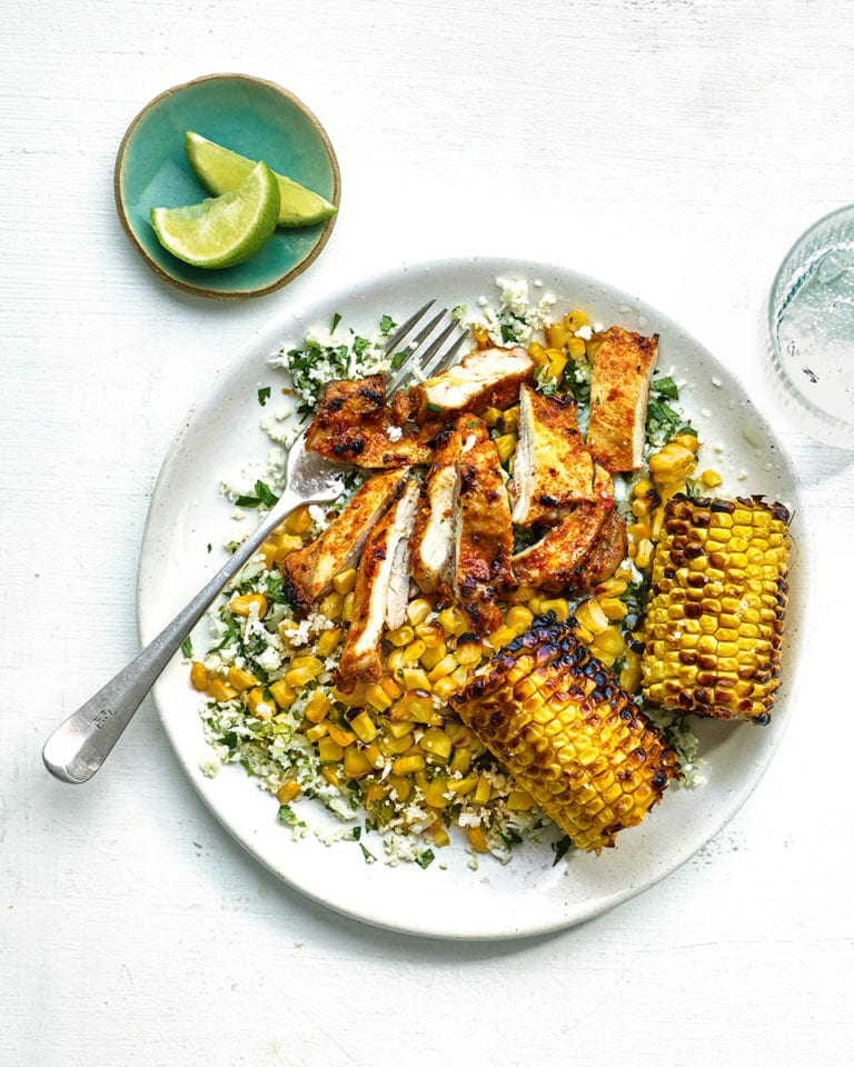 Peri-peri spiced chicken with cauliflower rice and charred corn cobs