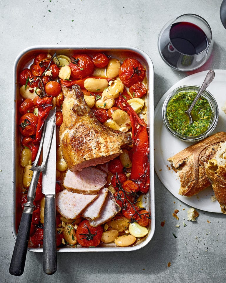 Ibérico pork loin with sherry roasted tomatoes, peppers and butter beans