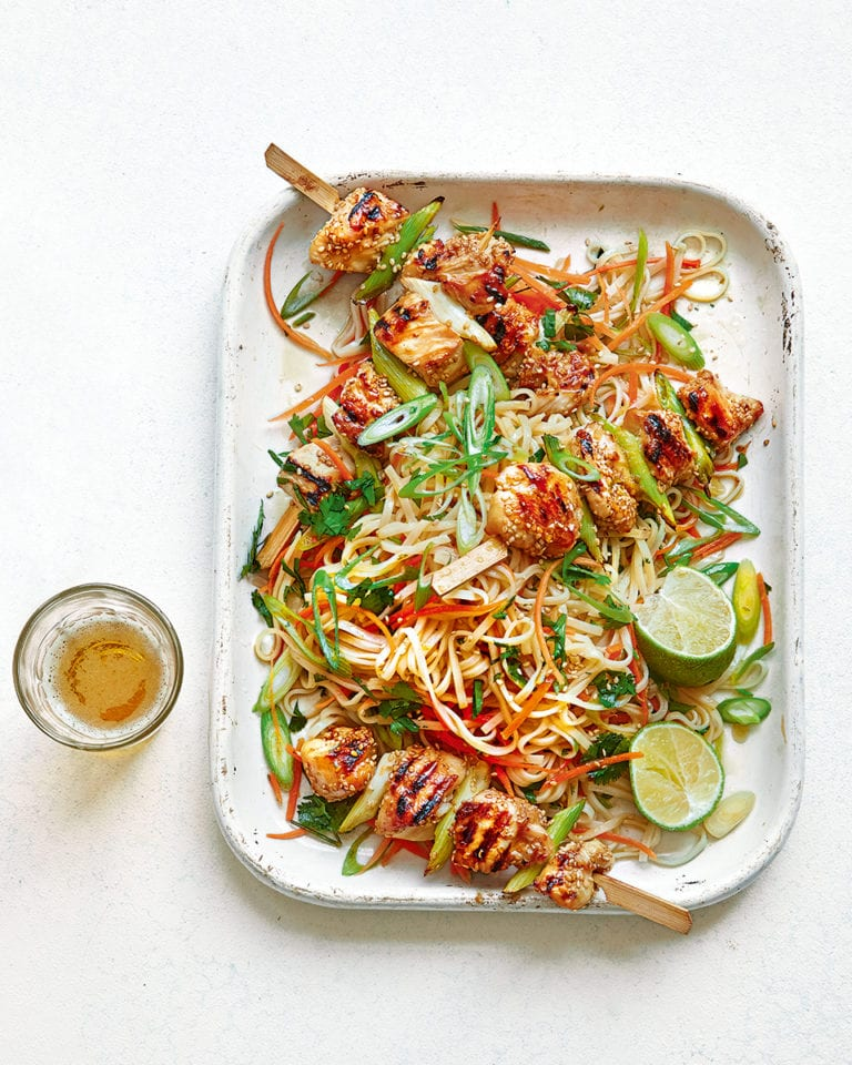 Sticky sesame chicken skewers with noodle salad