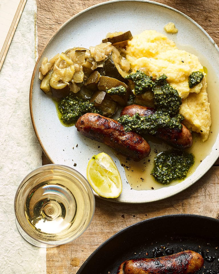 Sausages with polenta and braised courgettes