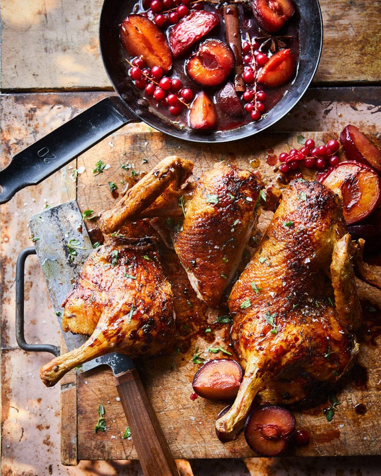 Spatchcock duck with plums and redcurrants